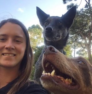 Close up of girl physiotherapist with two dogs.